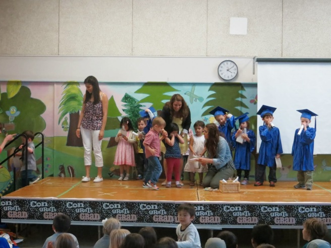 "Accepting his ""degree"" for completing 2 years of pre-school.  (He will graduate next year.)"